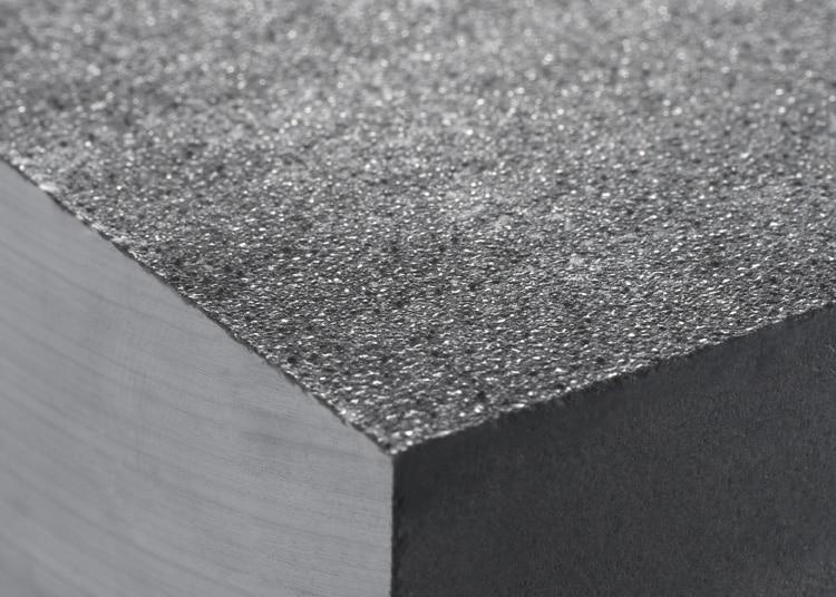 Dépôt de carbure de tungstene sous la forme d'une couche granuleuse